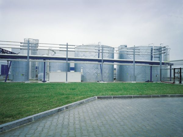 Outdoor biological treatment system for industrial waste water